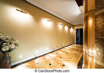 long corridor - flowers in a long corridor with parquet...