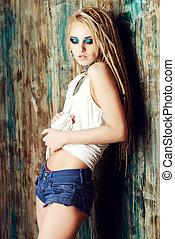 long dreadlocks - Modern girl with blonde dreadlocks. Jeans...