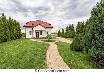 Long driveway to luxurious villa