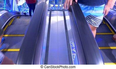 long escalators in modern mall.