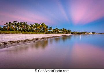 Long exposure at sunset of Smathers Beach, Key West, Florida.