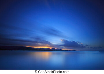 Long exposure dramatic tropical sea and sky sunset