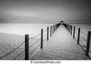 Long exposure image of old abandoned fisherman jetty in black and white