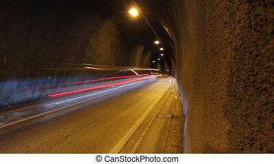 Long exposure in the illumated urban tunnel with trafic