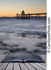 Long exposure landscape image of pier at sunset in Summer concep