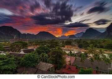 Long exposure landscape view panorama at Sunset in Vang Vieng, Laos.