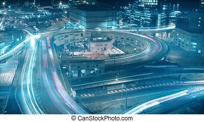 Long exposure night time lapse of busy city road interchange...