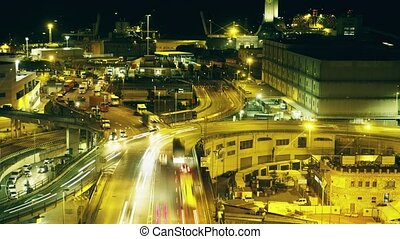 Long exposure night time lapse of busy industrial seaport...