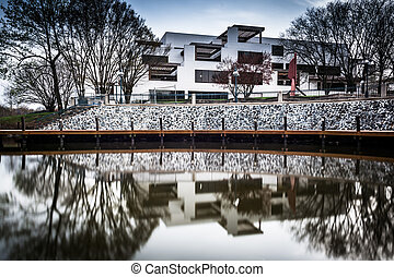 Long exposure of a building along the shore of Lake Kittamaqundi, in Columbia, Maryland.