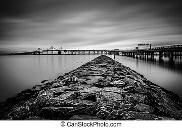 Long exposure of a jetty and the Chesapeake Bay Bridge, from...
