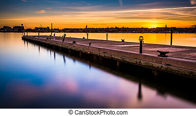 Long exposure of a pier at sunset, in Fells Point, Baltimore...
