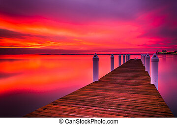 Long exposure of a pier at sunset, on the Chesapeake Bay in Kent Island, Maryland.