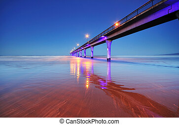 Long exposure of an ocean and New Brighton Pier Christchurch, New Zealand.