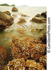 long exposure of beach and rocks