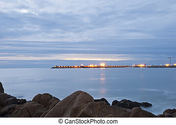Long exposure of beach with pier