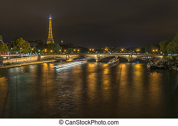 Long exposure of boats traffic in the Seine at night - View...