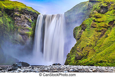 Long exposure of famous Skogafoss waterfall in Iceland at...