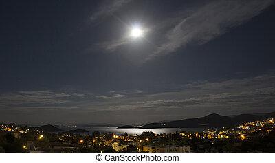 Long exposure of full moon in 2016 summer over Aegean sea at...