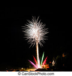 Long Exposure of Multicolored Fireworks Against a Black Sky...