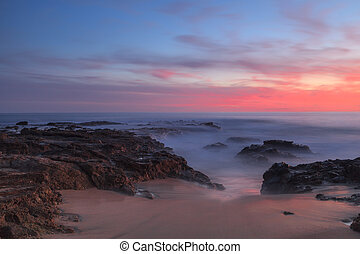 Long exposure of sunset over rocks