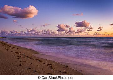 Long exposure of the Atlantic Ocean at sunrise, at Coral Cove Park, Jupiter Island, Florida