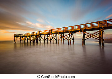Long exposure of the pier at Isle of Palms at sunrise, near ...