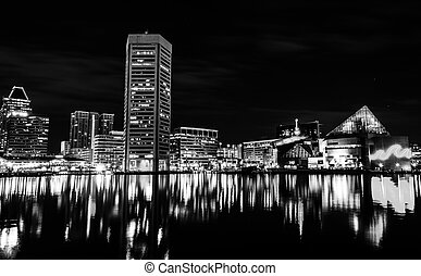 Long exposure of the skyline at night, from the Inner Harbor...