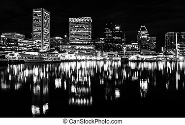 Long exposure of the skyline at night, from the Inner Harbor in Baltimore, Maryland.