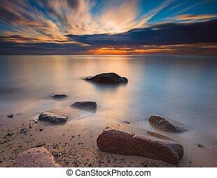 Long exposure rocky beach sunrise