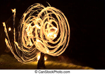 Long exposure shot of moving burning torches and fire