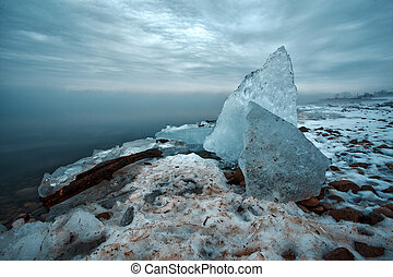Snow and Frozen Ice Sheets Piled Ashore - Long Exposure Snow...