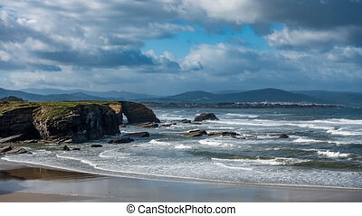 Long exposure time lapse in cathedral beach with holes in ...