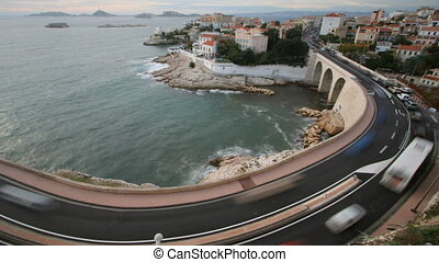 long exposure time-lapse shot of traffic on the bend in the corniche road, marseilles