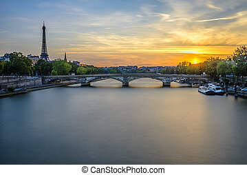 Long exposure view of Pont des Invalides and Eiffel tower at sunset from Pont Alexandre III