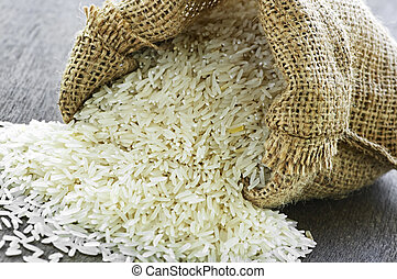 Long grain rice in burlap sack - Raw long grain white rice...