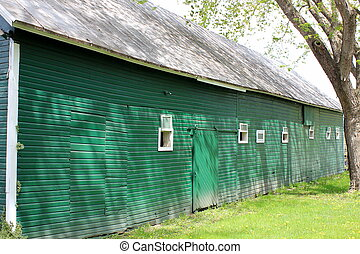 Long green barn and white windows
