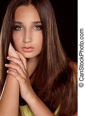 Long Hair. Beauty Woman with Healthy Brown Hair. Model Brunette Girl Studio Portrait.