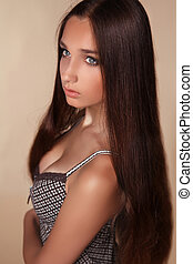 Long Hair. Beauty Woman with Healthy Shiny Smooth Brown Hair. Model Brunette Girl Studio Portrait.