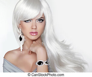 Long hair. Fashion Blond girl with white wavy hairstyle. Expensi