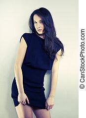 Long hair girl in studio portrait