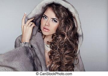 Long hair. Luxury beautiful wearing in mink fur coat with...