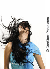 Long hair - Portrait of young hispanic beauty waving her...