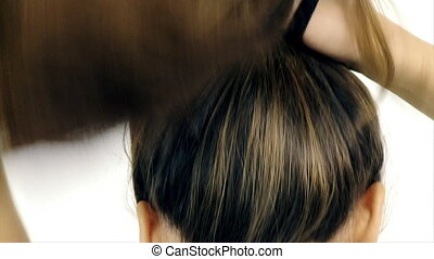 Long hair tied up in ponytail slow motion isolated closeup -...
