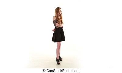 Long Hair Young Woman Dancing in Sexy Black Dress