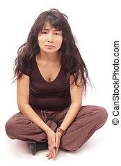 Asian girl sittng cross-legged - Long-haired Asian girl...