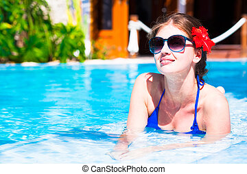 long haired beautiful woman in luxury pool