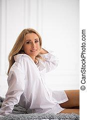 Long-haired beautiful woman looking at camera