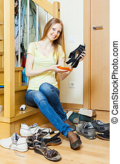 Long-haired blonde woman with shoes