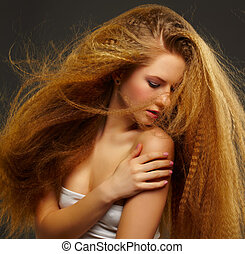 long-haired curly redhead woman - portrait of young...
