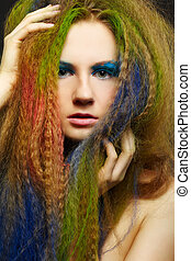 long-haired curly redhead woman - headshot portrait of young...